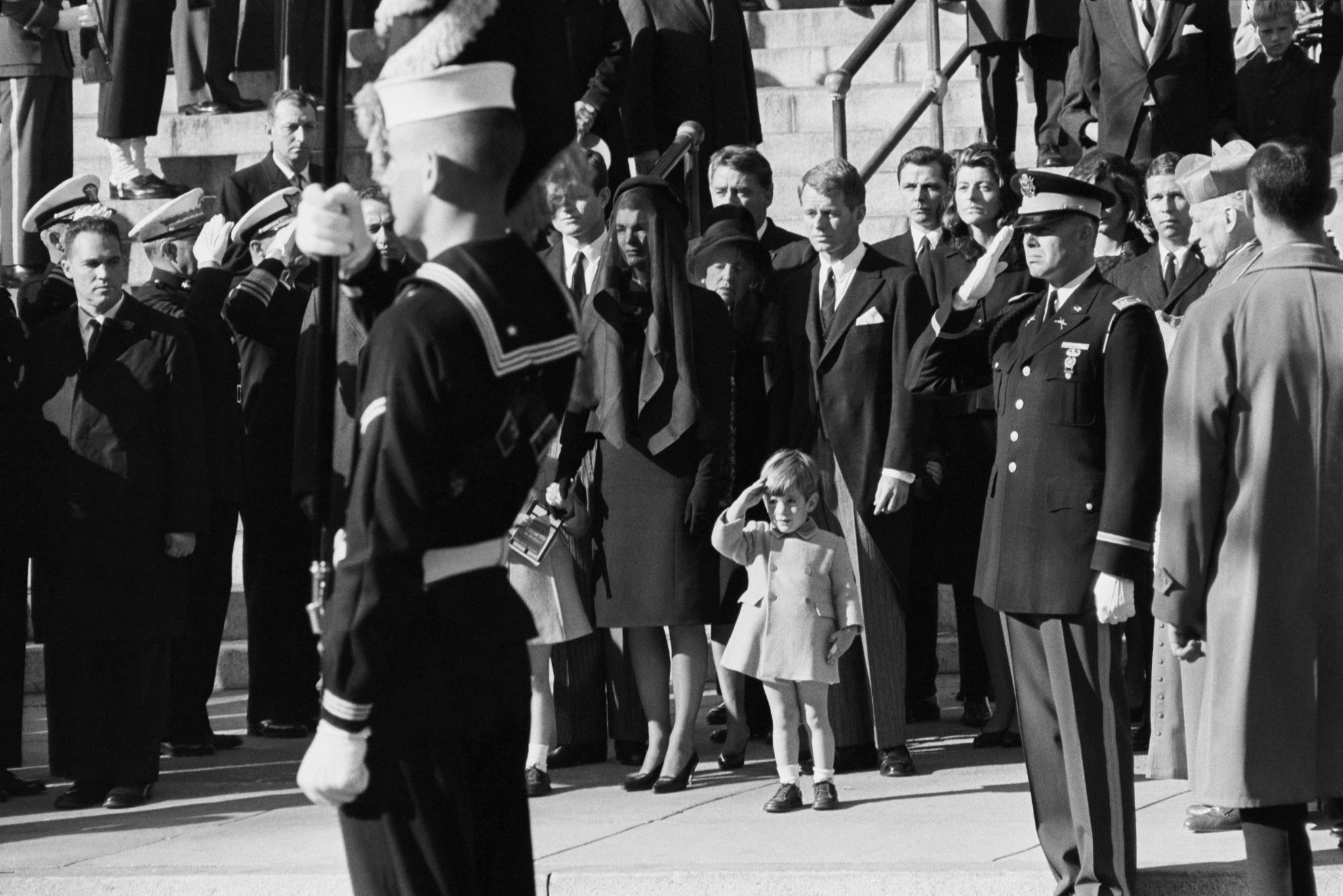 To mark the fortieth anniversary of John F. Kennedy's assassination, AMERICAN EXPERIENCE reprises The Kennedys, a dramatic portrait of America's most famous political family, airing Monday and Tuesday, November 17 and 18, at 9pm on PBS (check local listings). Here, John Kennedy Jr., age 3, salutes as his father's casket is carried from St. Matthew's Cathedral, Washington, DC; November 25, 1963. CREDIT: © Bettmann/Corbis USAGE: This image may be used in the direct promotion of AMERICAN EXPERIENCE. No other rights are granted. All rights are reserved.